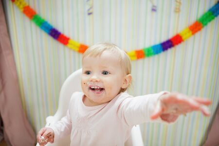 Eat smeared baby pulling hand in camera Stock Photo - 13407713
