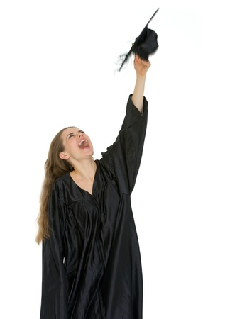 Happy graduation student throwing up cap photo