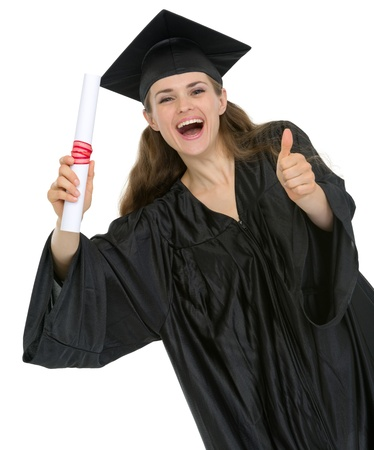 Happy graduation student girl with diploma showing thumbs up photo