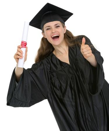 edificación: Ni�a feliz estudiante de la graduaci�n con un diploma que muestra los pulgares para arriba