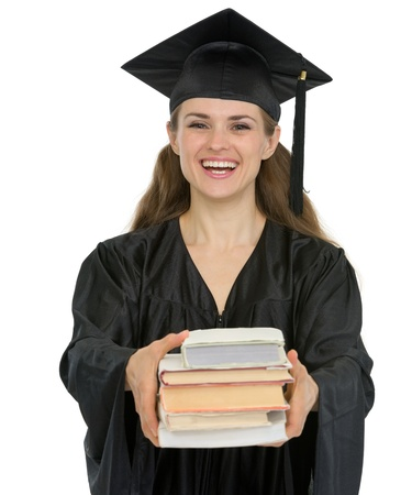 Graduation girl student giving stack of books photo