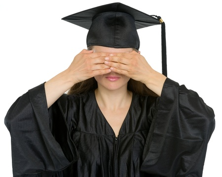 Graduation student girl making see no evil gesture photo