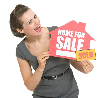 agents: Happy real estate owner with home for sale sold sign Stock Photo