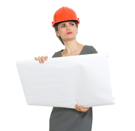 authoritative: Authoritative architect woman with flipchart looking into distance Stock Photo