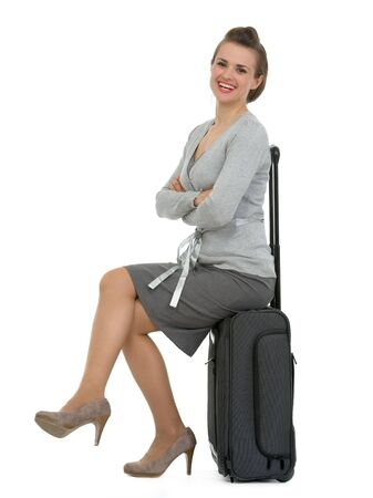 Smiling traveling woman sitting on suitcase Stock Photo - 13611555