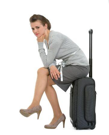 Upset traveling woman sitting on suitcase Stock Photo - 13611574