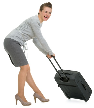 Tired traveling woman hauling suitcase Stock Photo - 13611554