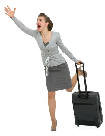 Hurry traveling woman with suitcase photo