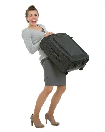 Tired traveling woman raising suitcase Stock Photo - 13611542