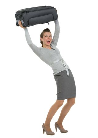 Traveling woman raising suitcase above head Stock Photo - 13611521