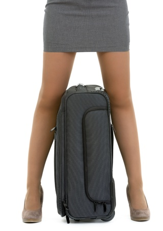 Closeup on suitcase between female legs Stock Photo - 13613595