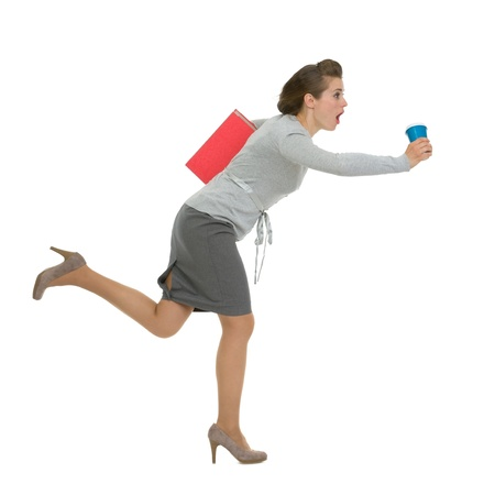 woman running: Hurry business woman with folder and cup running Stock Photo