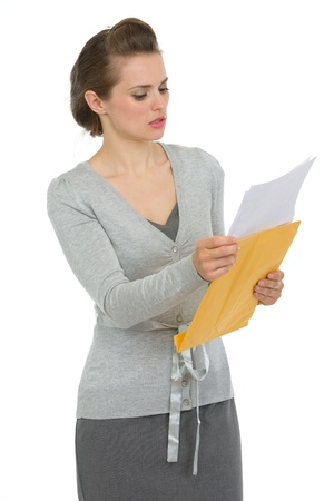 Concerned woman reading letter photo