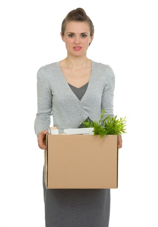 Woman employee holding box with personal items photo