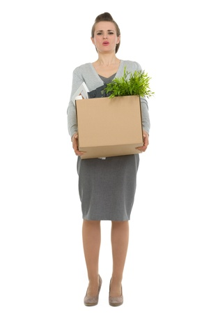 Tired woman employee dragging box with personal items photo