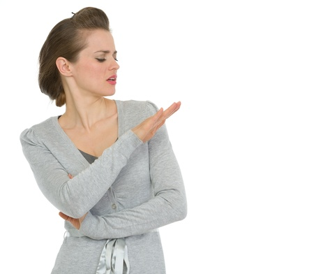Arrogant modern business woman looking on nails
