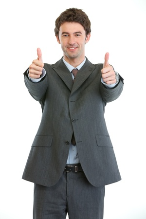 Modern businessman showing thumbs up photo
