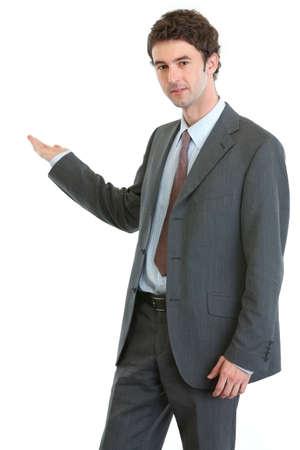 something: Modern businessman showing on something