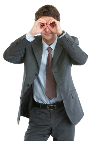 Modern businessman looking through binoculars shaped hands Stock Photo - 13702193