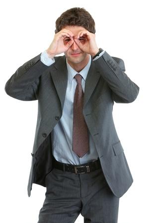 Modern businessman looking through binoculars shaped hands Stock Photo - 13702193