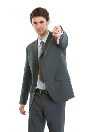 Modern businessman showing thumbs down Stock Photo - 13702141
