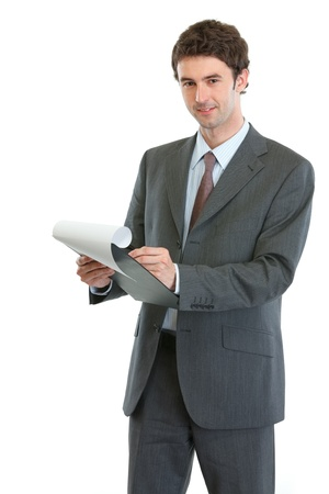 Modern businessman writing in clipboard photo