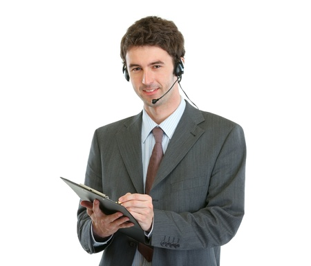 Modern business operator with headset writing in clipboard photo