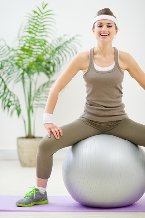 Fitness woman sitting on fitness ball Stock Photo - 13743452