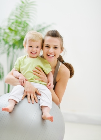 Portrait of happy mother and baby in gym Stock Photo