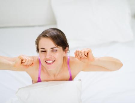 Woman stretching after awake Stock Photo - 13817636