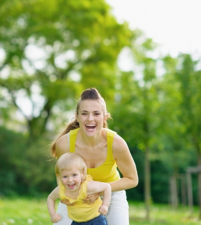 Portrait of happy mother and baby girl in park Stock Photo - 14003153
