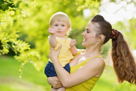 Portrait of mother and baby girl outdoors in park Stock Photo - 14003163