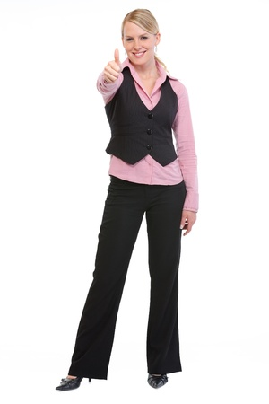 Full length portrait of employee woman showing thumbs up photo