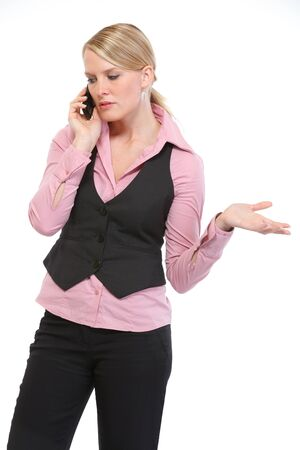 disquieted: Woman employee speaking mobile phone Stock Photo