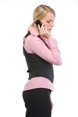 disquieted: Woman employee speaking mobile phone. Side view