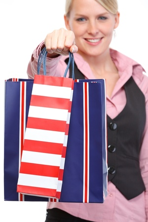 Happy woman giving shopping bags. Close up Stock Photo - 14003150