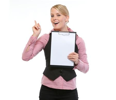 got: Woman employee showing blank clipboard Stock Photo