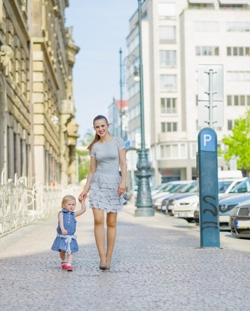 Mother and baby walking in city Stock Photo - 14031170