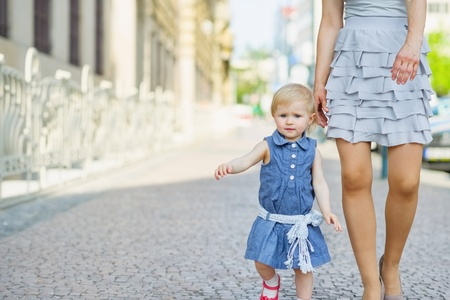Baby with mother walking in city Stock Photo - 14031137