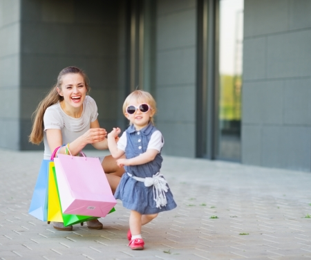 Fashion-monger baby on shopping with mom wear new glasses Stock Photo - 14031156
