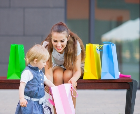 Mother and baby examines purchases after shopping photo