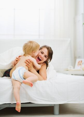 baby bedroom: Baby came to mother in bedroom Stock Photo