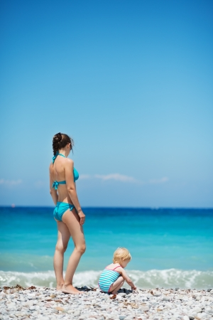 Mother and baby on sea shore. Rear view Stock Photo - 14246485