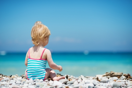 Baby sitting on beach. Rear view Stock Photo - 14246491