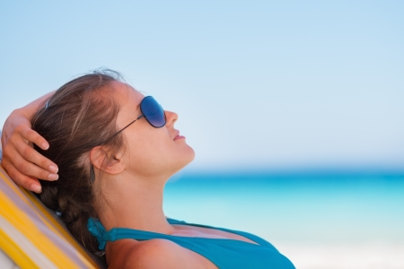 Relaxed woman laying on beach photo