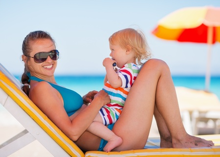 Portrait of happy mother and baby on sun bed Stock Photo - 14246472