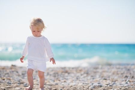 Baby walking on beach Stock Photo - 14246367