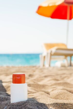 Bottle of sun block creme in shadow on beach Stock Photo - 14250401