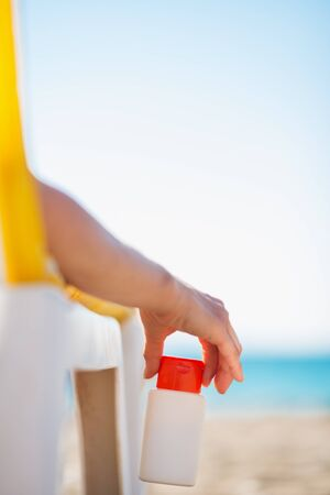 Closeup on bottle of sun block creme in female hand Stock Photo - 14250356