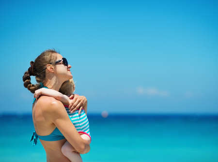 Mother embracing baby on beach Stock Photo - 14329489